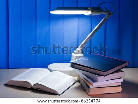 open book and pile books is on desk - stock photo