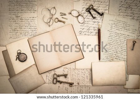 open book, antique accessories, old letters and cards. vintage nostalgic background - stock photo