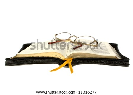 open book / bible and glasses on white background
