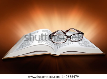 Open book Bible with cross and  glasses - stock photo