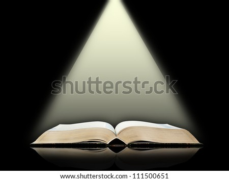 Open book, black background - stock photo