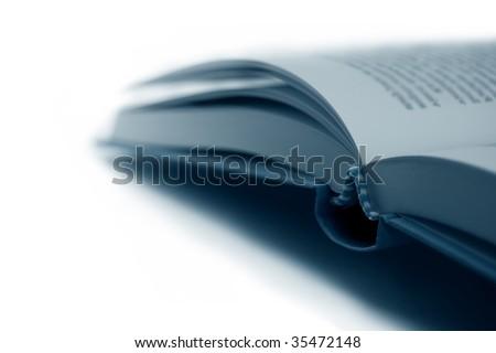 Open Book closeup, shallow DOF, isolated - stock photo