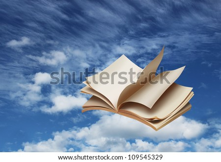 Open book flying on blue sky background fantasy