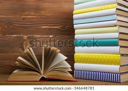 Open book, hardback books on wooden background. Back to school.  Copy space for text - stock photo
