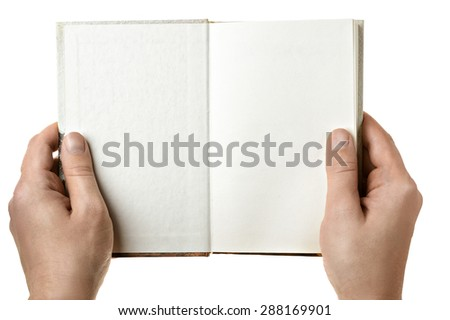 Open book in human hands - stock photo