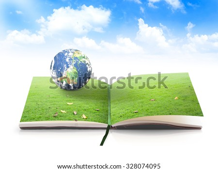 Open book in planet rest on beautiful green meadow over blue sky background. World Environment Day, Ecology, Go Green, Eco Friendly, Ecofriendly, CSR concept. Elements of this image furnished by NASA. - stock photo