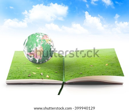 Open book in planet rest on beautiful green meadow over blue sky background. World Environment Day Ecology Go Green Eco Friendly CSR Nature School concept. Elements of this image furnished by NASA. - stock photo