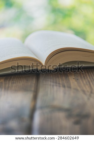 Open book in shallow focus with copy space - Split toned - stock photo