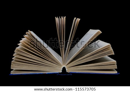 open book isolated on a black background closeup