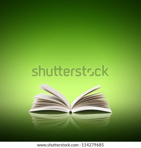 Open book isolated on green background - stock photo
