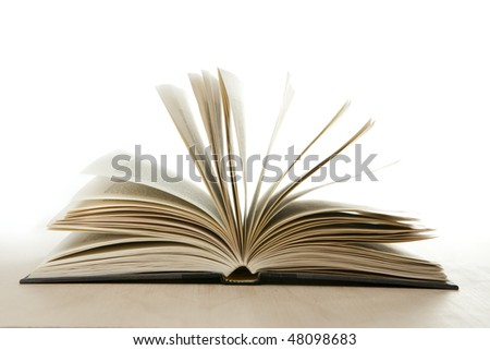 Open Book Isolated on White with Wood Surface