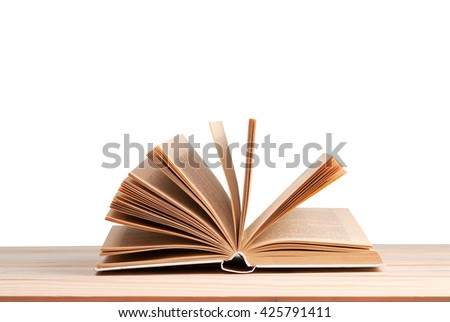 Open book isolated on wooden table. Back to school. Copy space. - stock photo