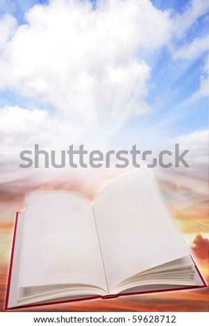 Open book on a heavenly scene - stock photo
