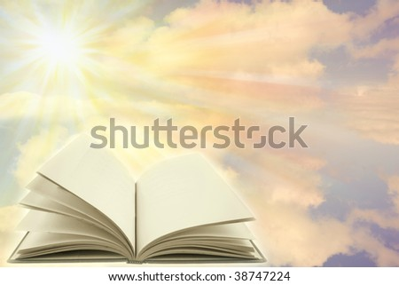 Open book on a heavenly scene. Copy space. - stock photo