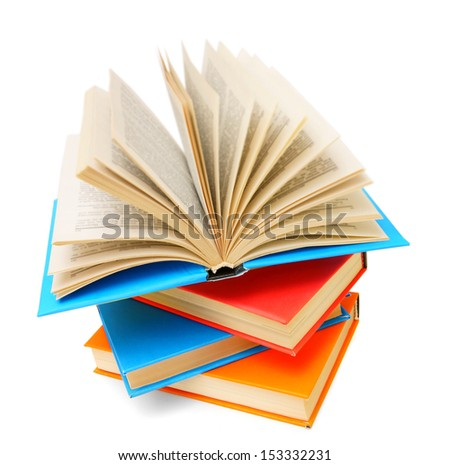 Open book on a pile of multi-coloured books. On a white background.