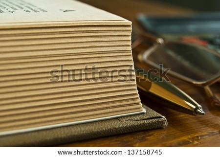 Open book on a wooden table. - stock photo