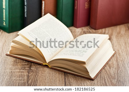 open book on background of several books - stock photo