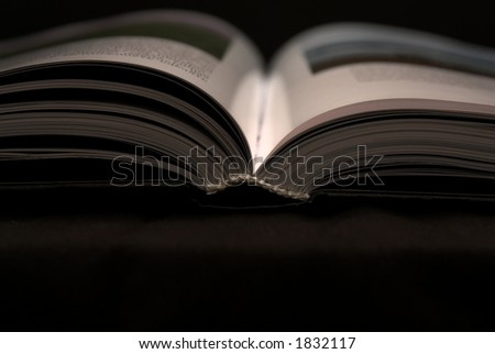 Open book on black background - stock photo