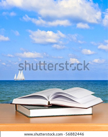 Open book on desk - stock photo