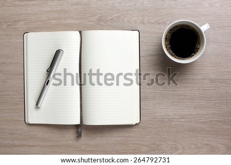 Open book on office desk - stock photo