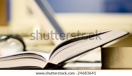 Open book on office table. Place for work and self-education - stock photo