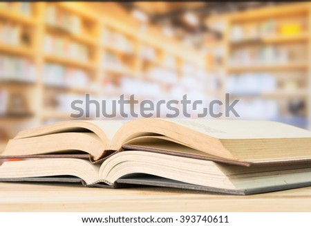Open book on the desk in library.  Education, books concept. - stock photo