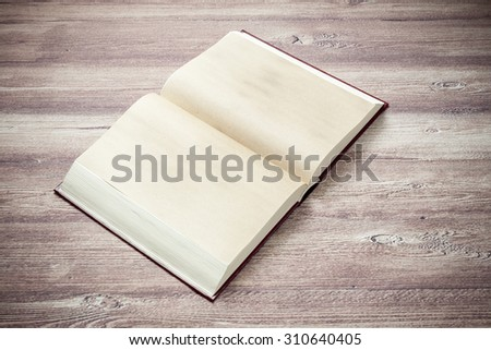Open book on the wooden table - stock photo