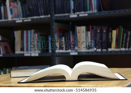 Open book on the wooden table, In the library, Knowledge concept