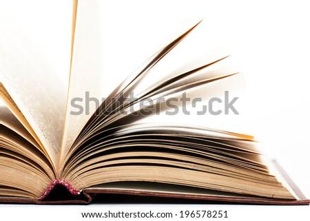 open book on white background. studio shot - stock photo