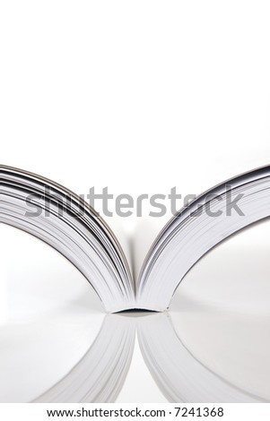 open book on white table - stock photo