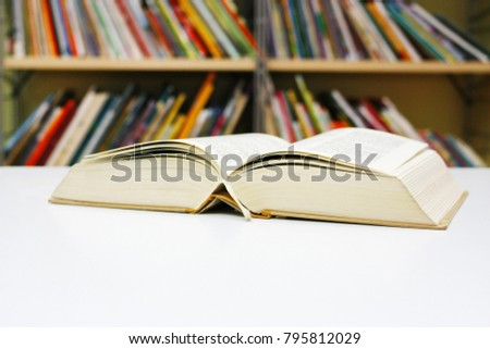 Open book on white table