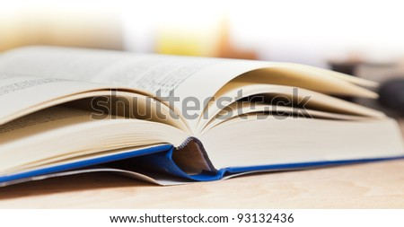 Open book on wood - stock photo