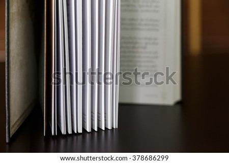 Open book on wood table. - stock photo