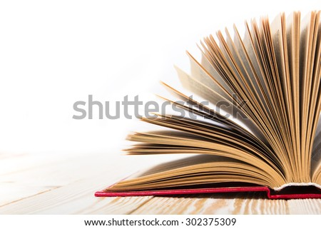 Open book on wooden table  isolated on white background. Back to school. Copy space