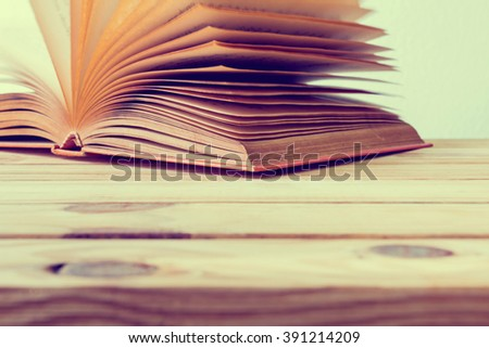 Open book on wooden table, selective focus - stock photo