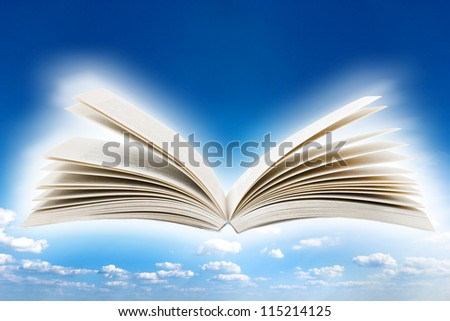 Open book over sky background - stock photo