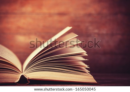 Open book. Photo in old color image style. - stock photo