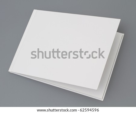 Open book's page on gray background - stock photo