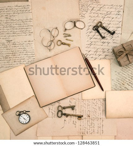 open book, vintage accessories, old letters and documents. nostalgic background - stock photo