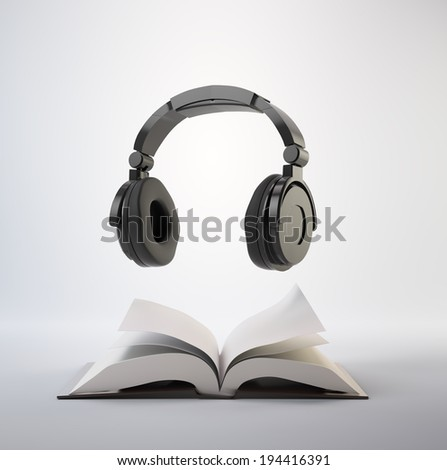 Open book with a headphone set - audiobook concept - stock photo