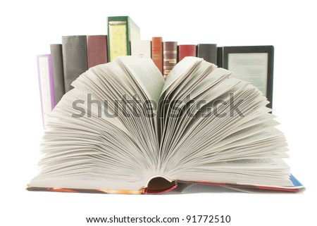Open book with a row of books and ebook behind it on white background - stock photo