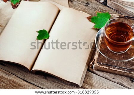 open book with blank pages on wooden table with a cup of black tea closeup. Copy space. Free space for test - stock photo