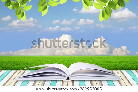 open book with blue sky and clouds
