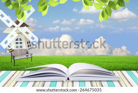 open book with blue sky and clouds - stock photo