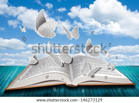 Open book with butterflies letters on blue sky - stock photo