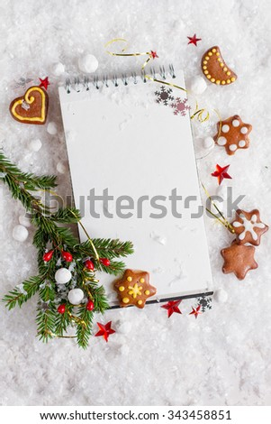 Open book with christmas decoration and gingerbread cookies, selective focus - stock photo