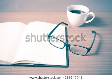 open book with coffee cup on wood background vintage style