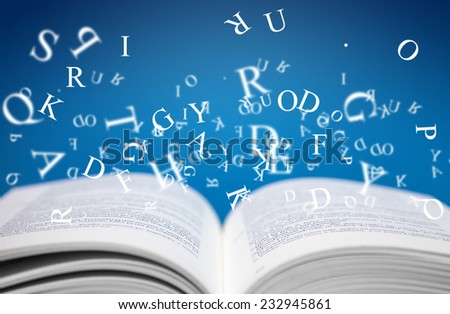 open book with letters on blue background