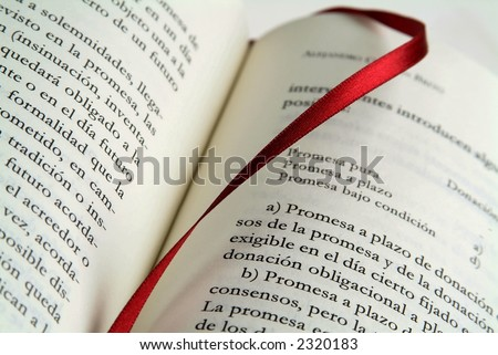 Open book with red ribbon marker