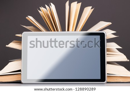 Open books and modern tablet computer, concept of evolution - stock photo